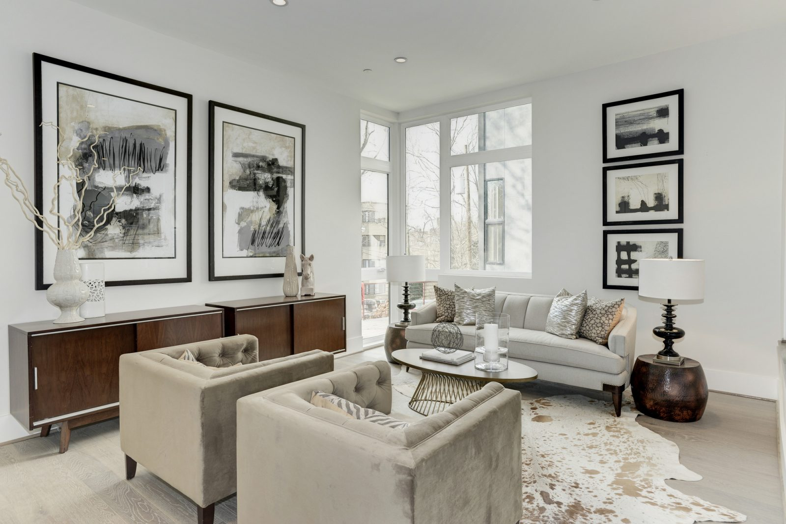 Living Room with Beige Furniture and Abstract Wall Art